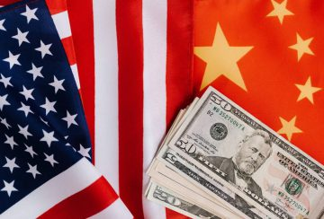 american-and-chinese-flags-and-usa-dollars-4386371